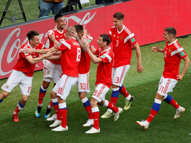 Russia's players celebrate going 2-0 up against Saudi Arabia in their Group A clash with Saudi Arabia in Moscow at the 2018 World Cup on June 14, 2018