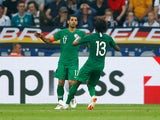 Saudi Arabia's Taiseer Al Jassam celebrates scoring their first goal with Yasser Al-Shahrani during the international friendly with Germany on June 8, 2018