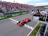 Ferrari's Sebastian Vettel passes the chequered flag to win the Canadian Grand Prix on June 10, 2018
