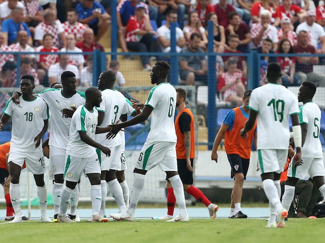 Senegal's players celebrate during their international friendly with Croatia in June 2018
