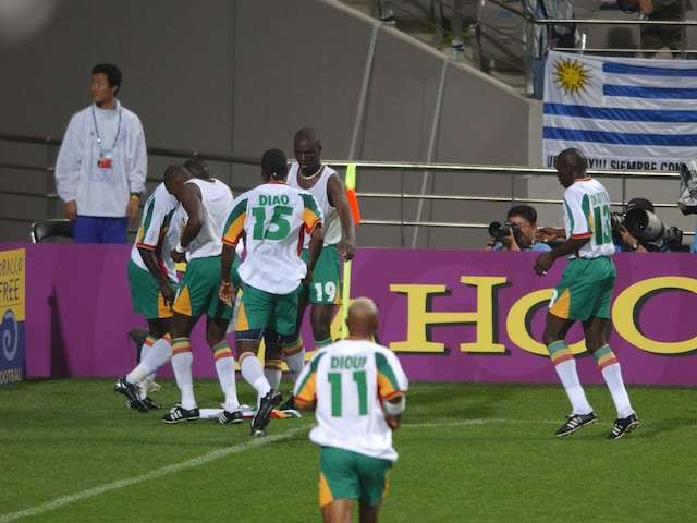 Senegal's players celebrate after scoring against France at the 2002 World Cup