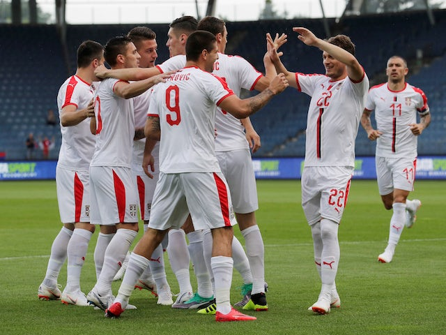 Serbia's players celebrate scoring in the international friendly against Bolivia on June 9, 2018