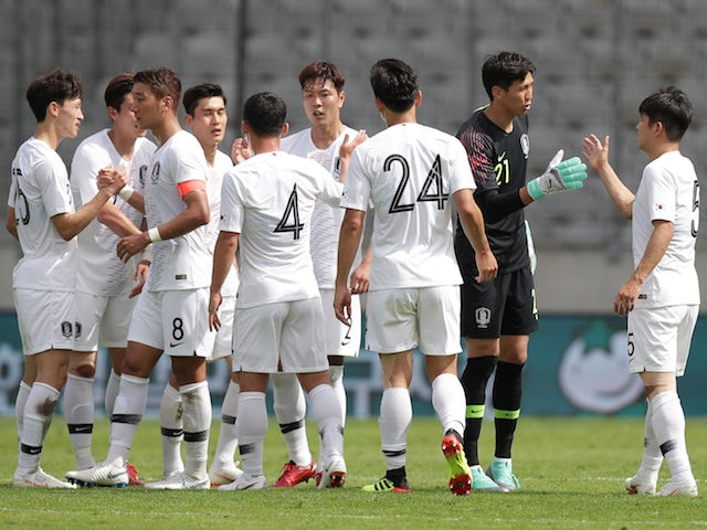 South Korea's players celebrate following their international friendly with Bolivia in June 2018