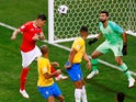 Switzerland's Steven Zuber scores their first goal in the match against Brazil on June 17, 2018