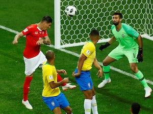 Switzerland's Steven Zuber scores their first goal in the match against Brazil on June 17, 2018