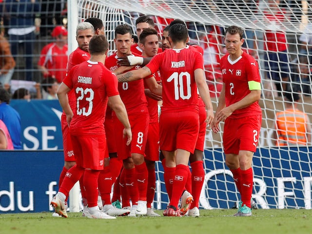 Switzerland's players celebrate a goal during their World Cup warm-up match against Japan on June 8, 2018