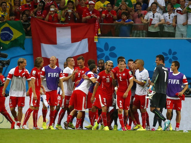 Switzerland's players celebrate qualifying from their group at the 2014 World Cup