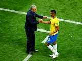 Brazil coach Tite shakes hands with Casemiro during the match against Switzerland on June 17, 2018