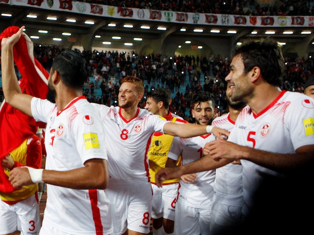 Tunisia's players celebrate qualifying for the 2018 World Cup