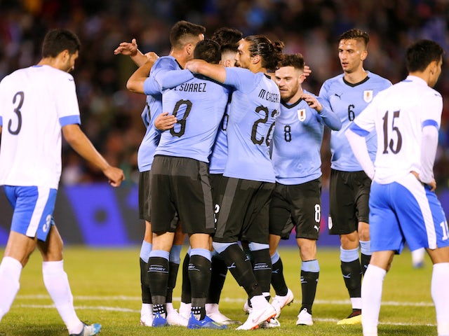 Uruguay's players celebrate scoring during an international friendly with Uzbekistan in June 2018