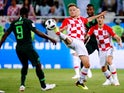 Croatia's Ivan Rakitic in action with Nigeria's Odion Ighalo in the World Cup group-stage match on June 16, 2018