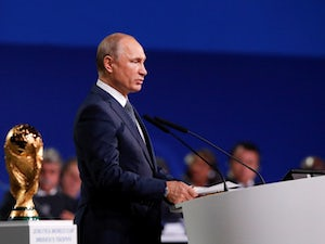 Vladimir Putin hints at Russia appeal against four-year WADA ban