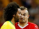 Switzerland's Xherdan Shaqiri reacts to Brazil's Marcelo during the World Cup match on June 17, 2018