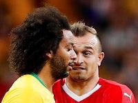 Switzerland's Xherdan Shaqiri reacts to Brazil's Marcelo during the World Cup match on June 17, 2018