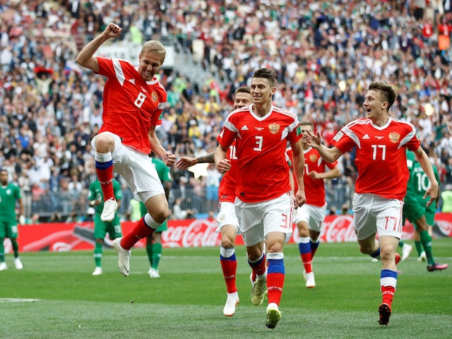 Yury Gazinsky scores the opener during the World Cup game between Russia and Saudi Arabia on June 14, 2018