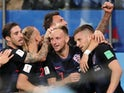 Croatia's Ante Rebic celebrates with teammates after scoring their first goal in the game against Argentina on June 21, 2018