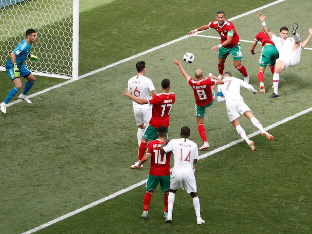Portugal forward Cristiano Ronaldo scores the opening goal during his side's World Cup Group B clash against Morocco on June 20, 2018