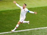 Portugal forward Cristiano Ronaldo celebrates scoring the opening goal during his side's World Cup Group B clash against Morocco on June 20, 2018