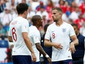 England's Jordan Henderson talks to Ashley Young and Harry Maguire during the match against Panama on June 24, 2018