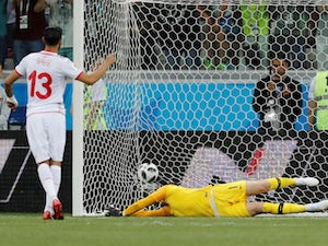 Tunisia's Ferjani Sassi scores their first goal past England's Jordan Pickford from the penalty spot on June 18, 2018