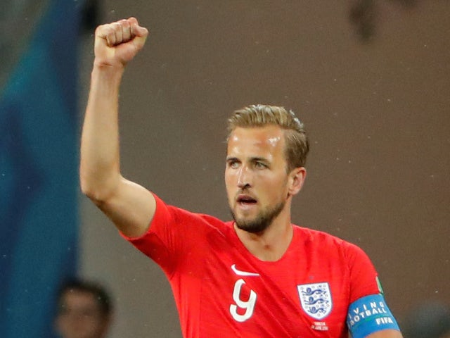 England's Harry Kane celebrates scoring their first goal in the World Cup match against Tunisia on June 18, 2018