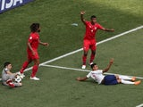England's Jesse Lingard is fouled for a penalty as Panama's Roman Torres and Fidel Escobar react on June 24, 2018