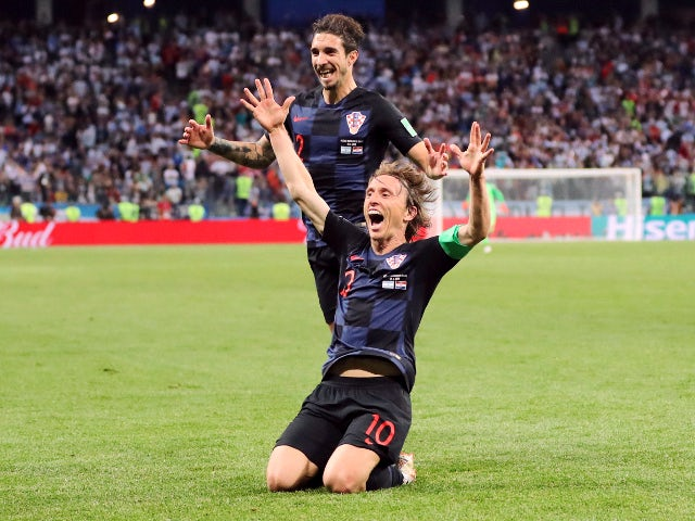 Croatia's Luka Modric celebrates with Sime Vrsaljko after scoring their second goal against Argentina on June 21, 2018