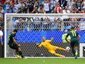 Mile Jedinak equalises from the spot during the World Cup group game between Denmark and Australia on June 21, 2018