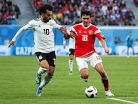 Egypt's Mohamed Salah in action with Russia's Yuri Zhirkov in the World Cup match on June 19, 2018