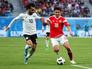 Russia beat Egypt to close on qualification