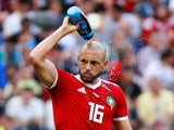 Morocco's Nordin Amrabat splashes water on himself during the match against Portugal on June 20, 2018