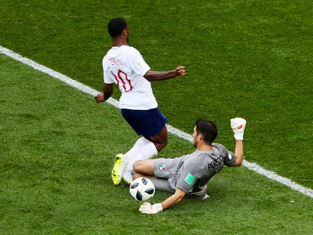 Panama's Jaime Penedo in action with England's Raheem Sterling on June 24, 2018