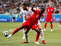 England's Raheem Sterling in action with Tunisia's Yassine Meriah on June 18, 2018
