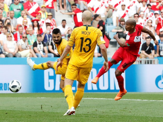 Peru's Andre Carrillo scores their first goal against Australia on June 26, 2018