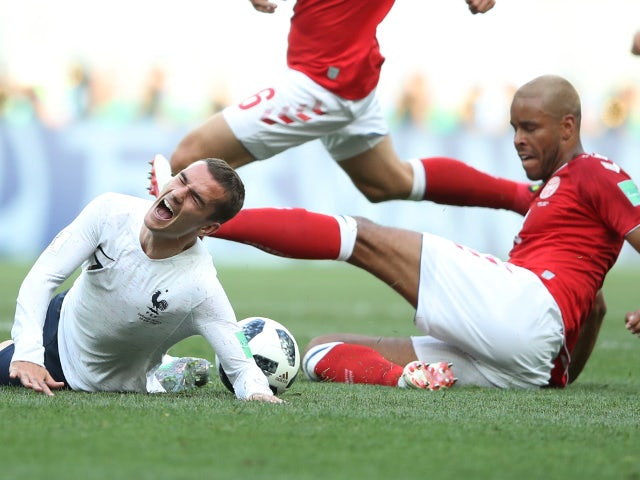 Denmark's Mathias Jorgensen fouls France's Antoine Griezmann prompting referee Sandro Ricci to award the Denmark player a yellow card on June 26, 2018