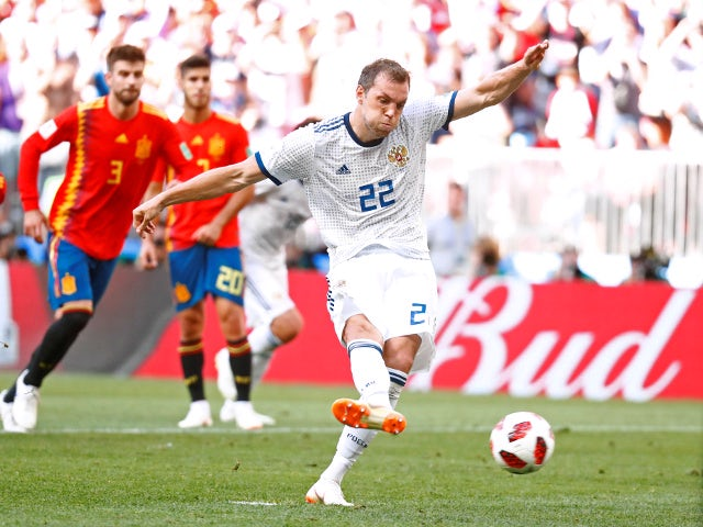 Russia's Artem Dzyuba scores their first goal from a penalty in the game against Spain on July 1, 2018