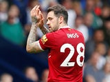 Liverpool's Danny Ings applauds fans as he is substituted off against West Bromwich Albion on April 21, 2018