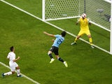 Uruguay's Edinson Cavani scores their first goal past Portugal's Rui Patricio on June 30, 2018