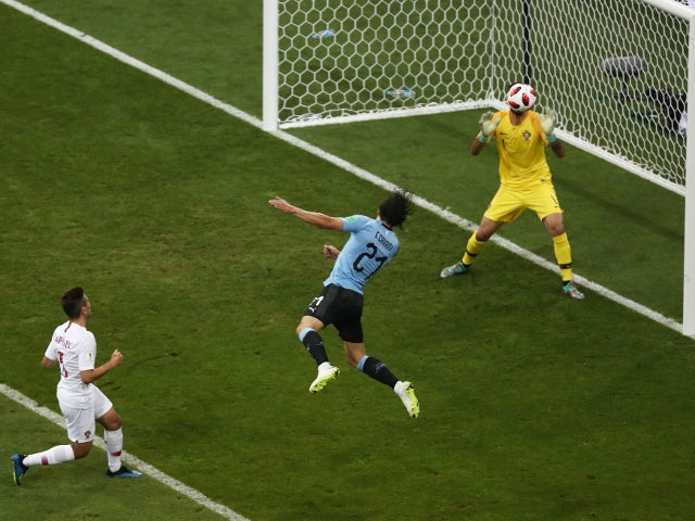 Uruguay's Edinson Cavani scores their first goal past Portugal's Rui Patricio on June 30, 2018