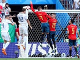Spain's Gerard Pique handles the ball in the area resulting in a penalty being awarded to Russia on July 1, 2018