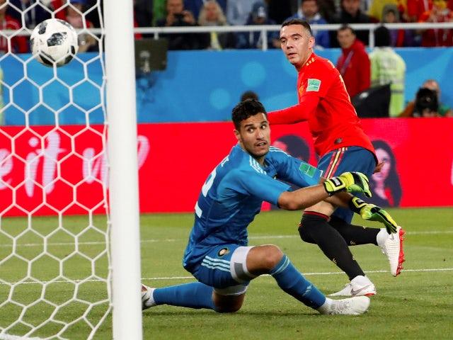 Spain's Iago Aspas scores their second goal against Morocco on June 25, 2018