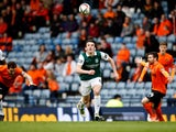Hibernian's John McGinn in action with Dundee United's Paul Paton and Ryan Dow on April 16, 2016