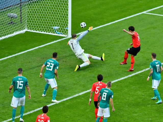 South Korea's Kim Young-gwon scores their first goal in the game against Germany on June 27, 2018