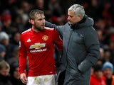 Manchester United manager Jose Mourinho speaks with Luke Shaw as he is substituted off against Bournemouth on December 13, 2017