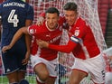 Matty Pearson celebrates with Angus MacDonald after scoring Barnsley's first goal against Nottingham Forest on August 15, 2017