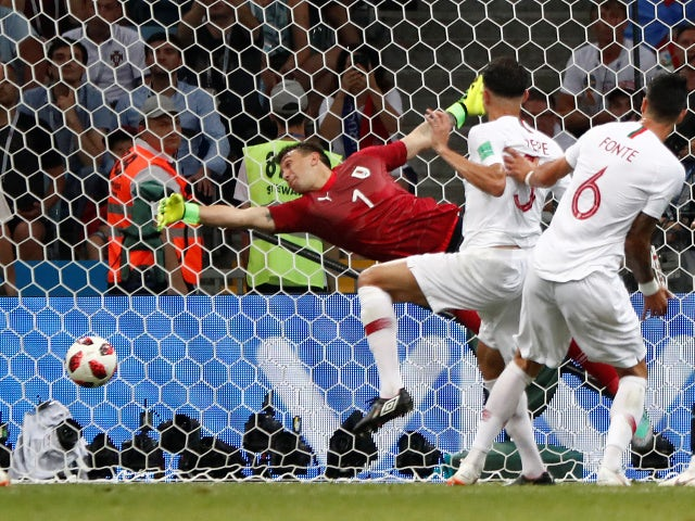 Portugal's Pepe scores their first goal against Uruguay on June 30, 2018