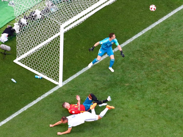 Russia's Sergei Ignashevich scores an own goal and the first for Spain on July 1, 2018