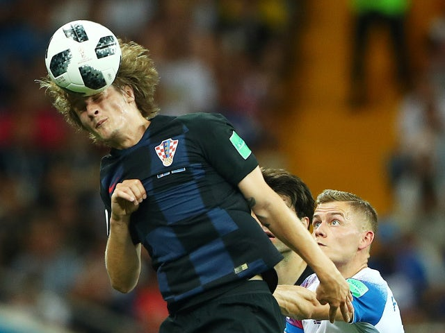 Croatia's Tin Jedvaj in action with Iceland's Alfred Finnbogason on June 26, 2018