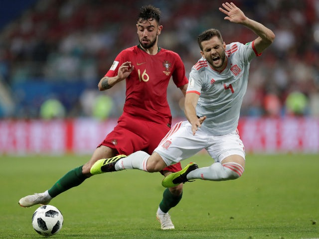 Spain's Nacho in action with Portugal's Bruno Fernandes on June 15, 2018