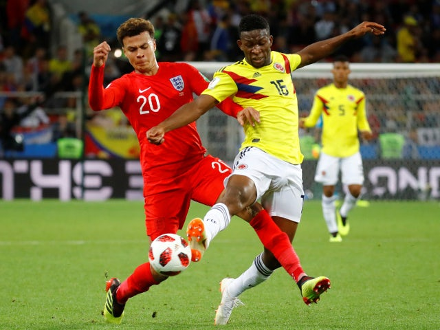 England's Dele Alli in action with Colombia's Jefferson Lerma on July 3, 2018
